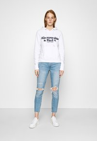 Abercrombie & Fitch - KNEE CURVE LOVE  - Jeans Skinny Fit - blue denim - 1