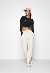 Nly by Nelly - FANCY JOGGERS - Tracksuit bottoms - off-white - 1