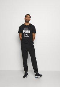 Puma - BOX TEE - Print T-shirt - black - 1