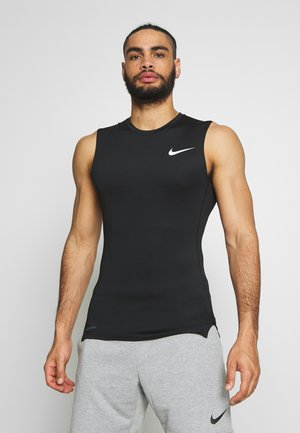 M NP TOP SL TIGHT - Sports shirt - black /white