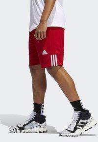 adidas Performance - SPEED REVERSIBLE SHORTS - Urheilushortsit - red - 2