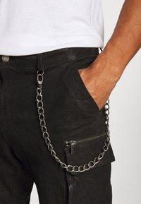 Tigha - ENRIQUE - Leather trousers - black - 4