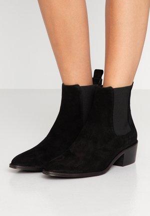 UBI - Korte laarzen - schwarz