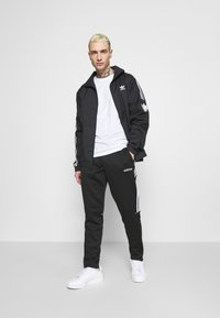 adidas Originals - UNISEX - Training jacket - black - 1