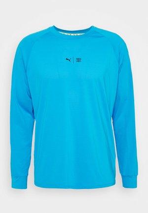 TRAIN FIRST MILE XTREME LONG SLEEVE TEE - Sports shirt - blue