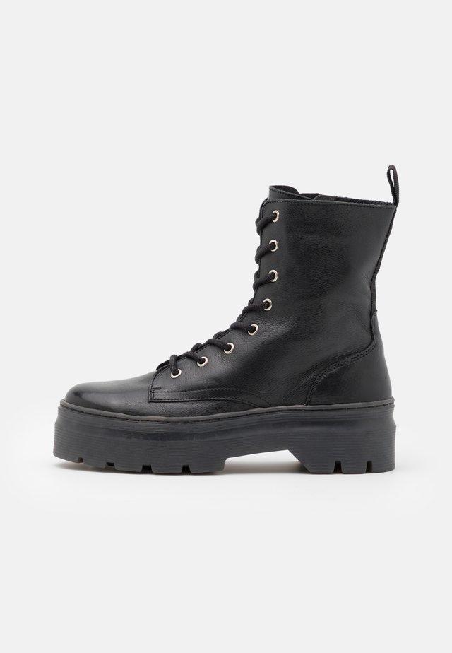 AVELINE - Platform ankle boots - black