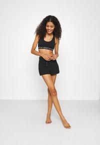 Calvin Klein Underwear - SLEEP SHORT - Pantaloni del pigiama - black - 1