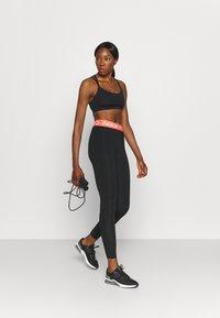 Nike Performance - Legginsy - black/magic ember/white - 1