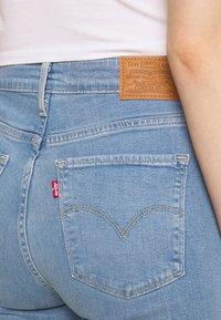 Levi's® - 725 HIGH RISE BOOTCUT - Bootcut jeans - light-blue denim - 4
