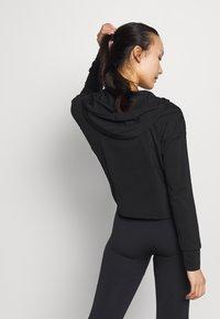 Nike Performance - YOGA HOODIE - Long sleeved top - black/dark smoke grey - 2