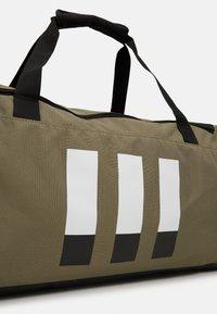 adidas Performance - Sports bag - green/black/white - 4