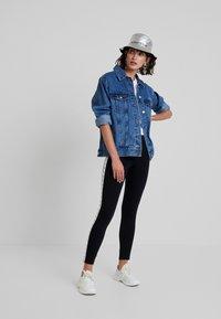 Calvin Klein Jeans - MONOGRAM TAPE MILANO - Leggings - Trousers - ck black/ bright white - 1