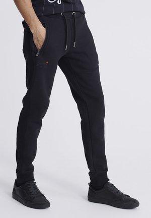 ORANGE LABEL - Pantalones deportivos - black