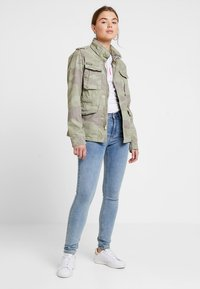 Superdry - DELTA SOFT CAMO ROOKIE - Summer jacket - khaki