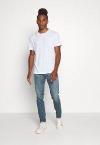 Diesel - D-STRUKT - Jeans Tapered Fit - indigo - 1