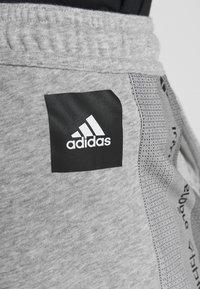 adidas Performance - Tracksuit bottoms - medium grey heather - 5