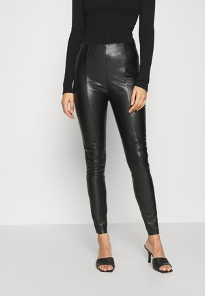 VMMODANIMA - Trousers - black