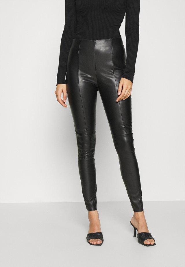 VMMODANIMA - Trousers - black