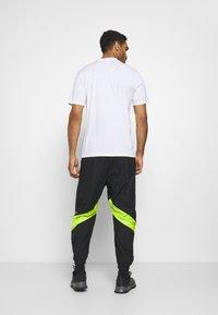 adidas Performance - URBAN PANT - Jogginghose - black/neon green - 2