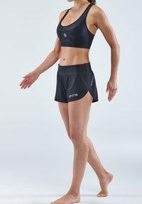 Skins - Sports shorts - black - 3