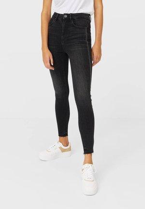 MIT SEITLICHEM STREIFEN - Jeans Skinny Fit - black
