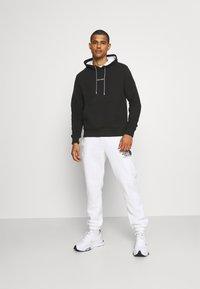 Calvin Klein - SUMMER GRAPHIC BACK PRINT HOODIE - Felpa - black - 1