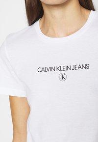 Calvin Klein Jeans - ROUND TEE - Print T-shirt - white - 4