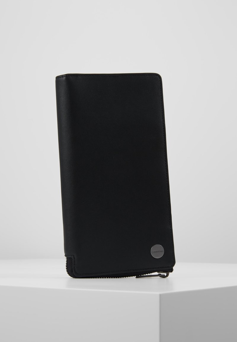 Calvin Klein - TRAVEL LONG WALLET - Lompakko - black