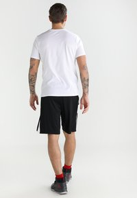 Jordan - ALPHA DRY - Sports shorts - black/white/white