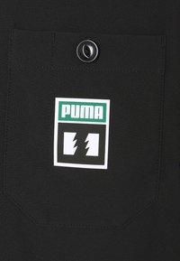 Puma - PUMA X TH CHORE JACKET - Summer jacket - black - 2