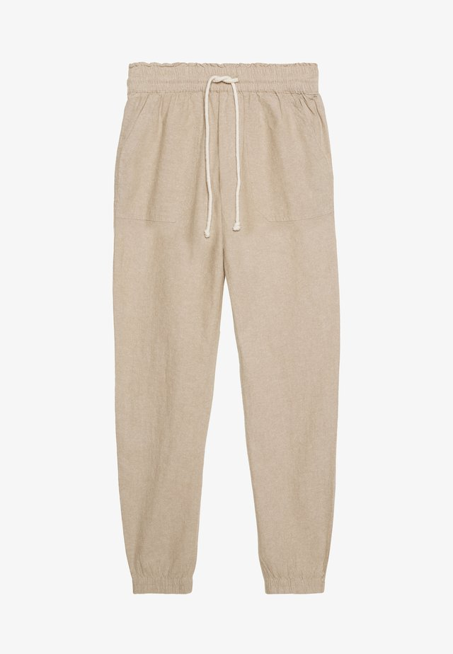RELAXED TRACKPANTS - Spodnie treningowe - beige/white