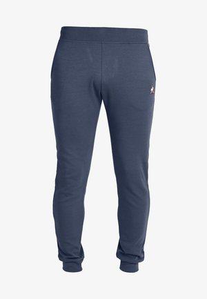 ESS SLIM N1 - TRACKSUIT BOTTOMS - Pantalones deportivos - navy blue