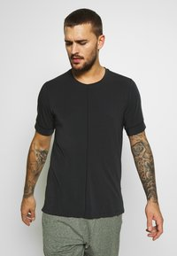 Nike Performance - DRY YOGA - Basic T-shirt - black - 0