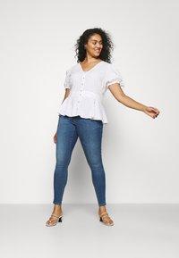 ONLY Carmakoma - CARSALLY LIFE - Jeans Skinny Fit - medium blue denim - 1