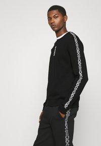 HUGO - DOBY - Long sleeved top - black - 3