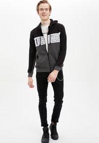 DeFacto - Zip-up hoodie - black - 1