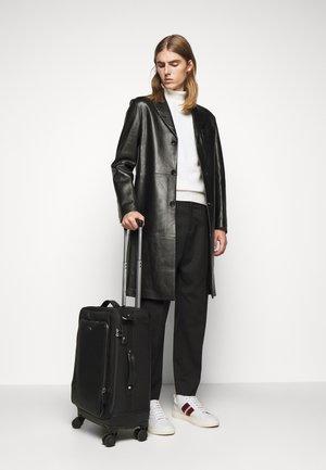 THONSON - Wheeled suitcase - black