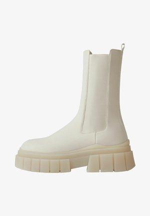 MIT ELASTISCHEM  - Classic ankle boots - beige