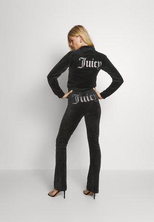 FREYA - Pantalon de survêtement - black