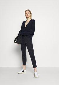 Marks & Spencer London - BELTED TROUSER - Kalhoty - dark blue - 1