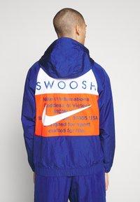 Nike Sportswear - Summer jacket - deep royal blue/team orange/white - 2