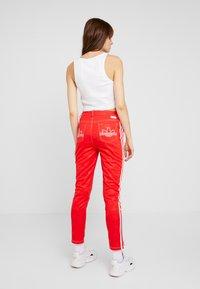adidas Originals - TRACKPANT - Jogginghose - red - 2