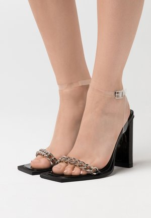 High heeled sandals - clear/black