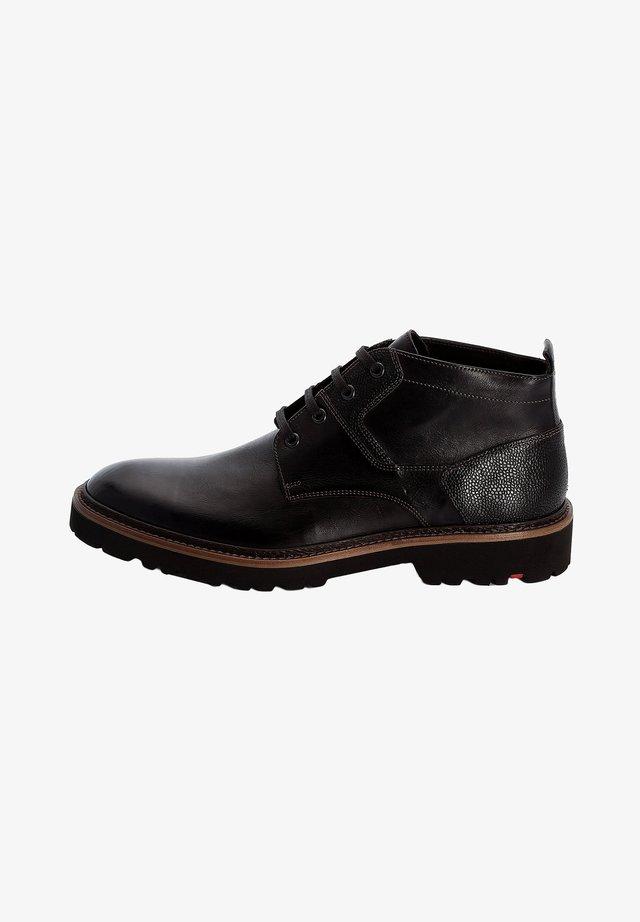 GANDA - Lace-up ankle boots - schwarz