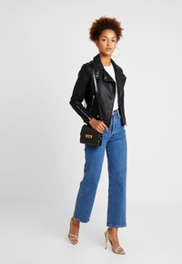 Topshop - LUCKY - Faux leather jacket - black - 1