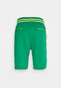 Schott - Tracksuit bottoms - green/yellow - 1