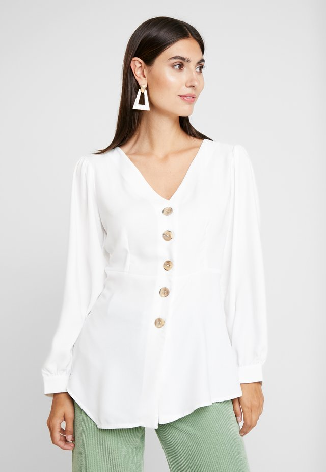 V NECK BUTTONED BLOUSE WITH UNEVEN HEM - Bluser - white