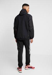 adidas Originals - HOODED JACKET - Windbreakers - black - 2