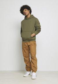 adidas Originals - BASICS HOODIE UNISEX - Sweatshirt - olive - 1