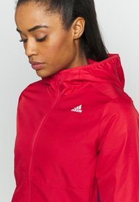 adidas Performance - OWN THE RUN - Training jacket - red - 4